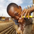 1 March 2016 - Tembisa - Thabiso Mojela (10) enjoys a few sips of water from the brand new push tap installed at his home in Tembisa. The tap, that only functions when pushed down is designed to save water and was supplied as part of a water saving strategy in Tembisa by Sunlight. Picture: Thys Dullaart