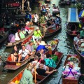 Trade and tourism at Bangkok's floating market.
