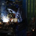 Industrial worker welding.