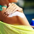 Image: iStock - Woman applying sunblock protection on shoulders