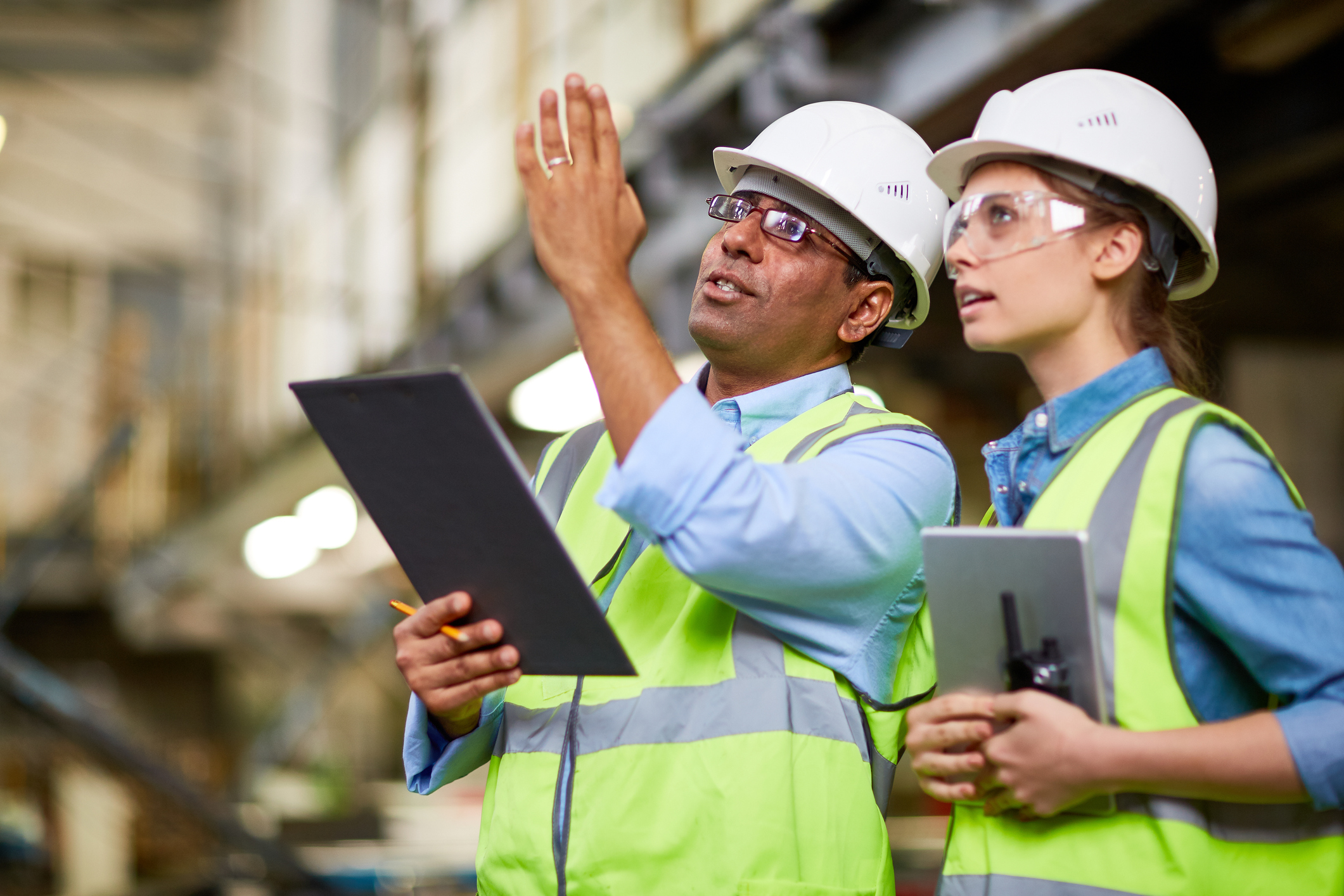 Image: iStock - Male engineer showing the project to his colleague.