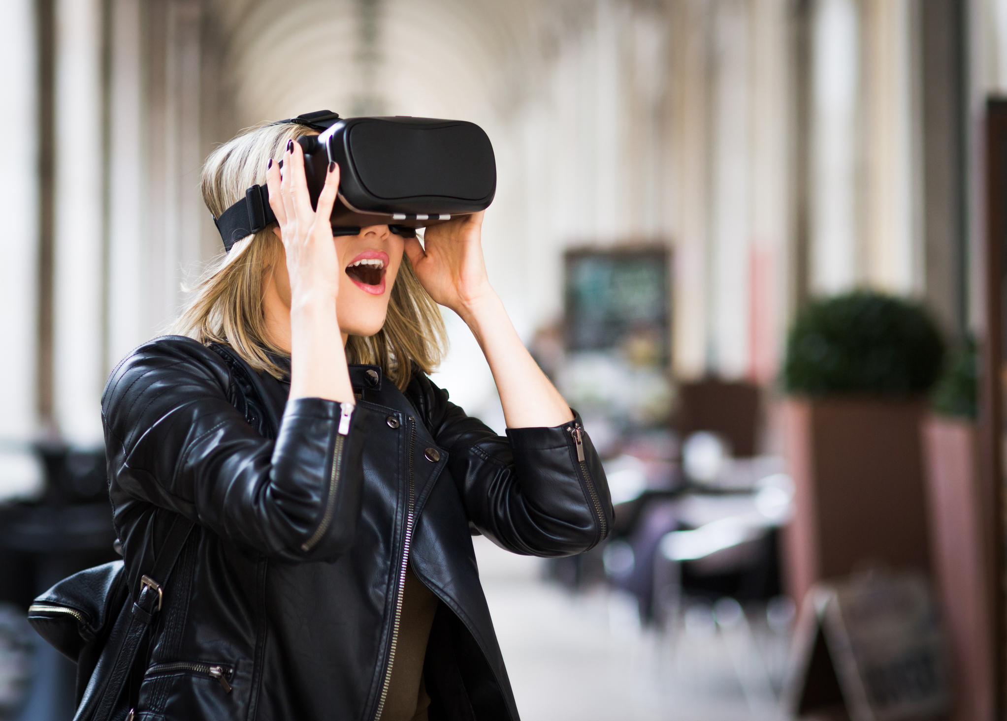 Image: iStock - Women testing Virtual Reality simulator on the street
