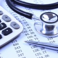 Image: iStock© - Stethoscope with financial statement