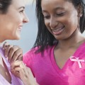 Image: iStock© - Two teenage girls at a breast cancer awareness rally