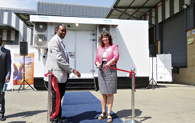 Image: Siemens E-House ribbon cutting - Siemens SA's Clifford Klaas and Sabine Dall'Omo