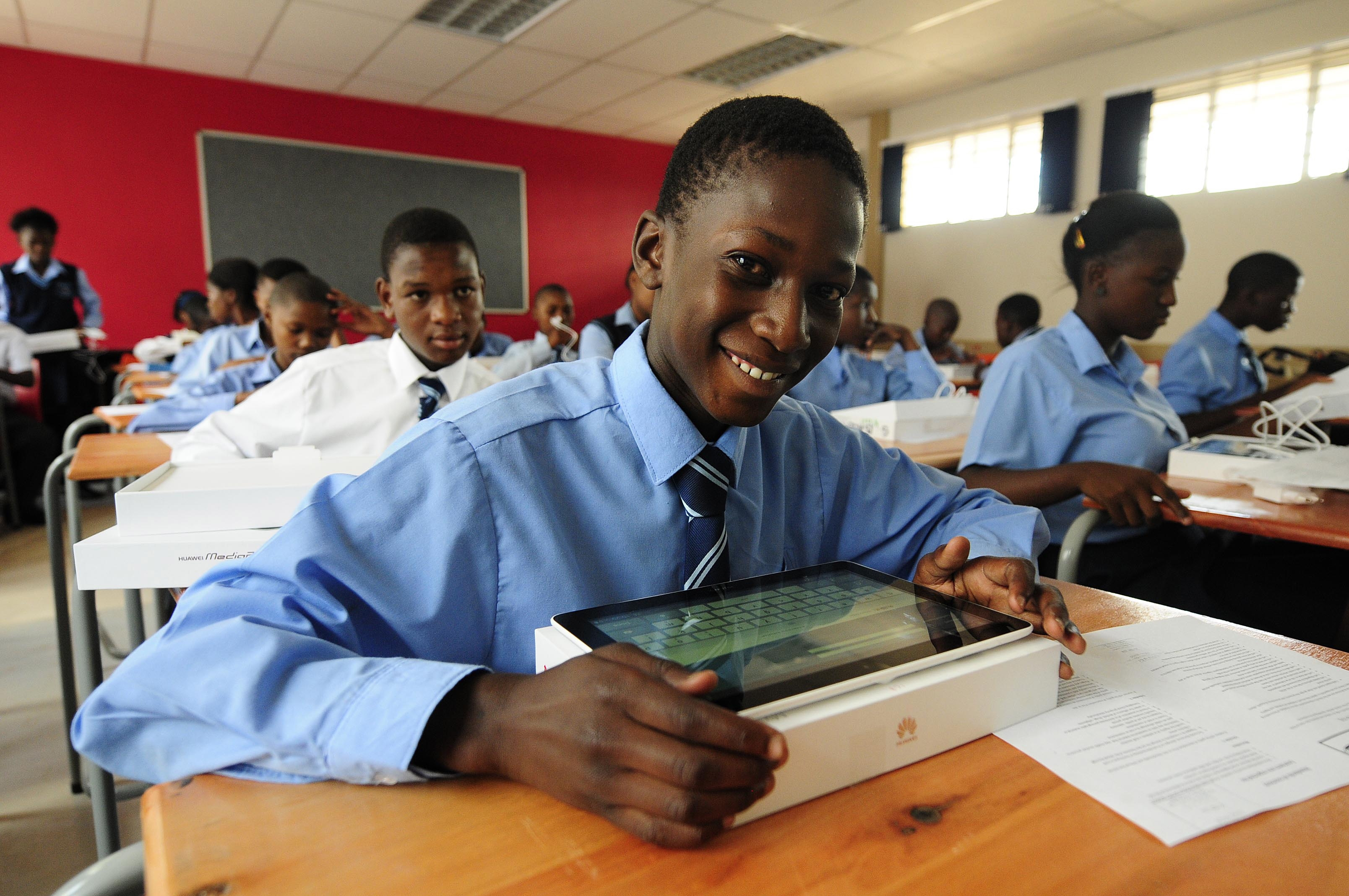 Image: Pupils work on their tablets on at Boitumelong Secondary School in Tembisa in Johannesburg, South Africa. (Photo by Thulani Mbele/Sowetan/Gallo Images/Getty Images)