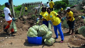 Municipal officials roll up their sleeves to clean up the municipality