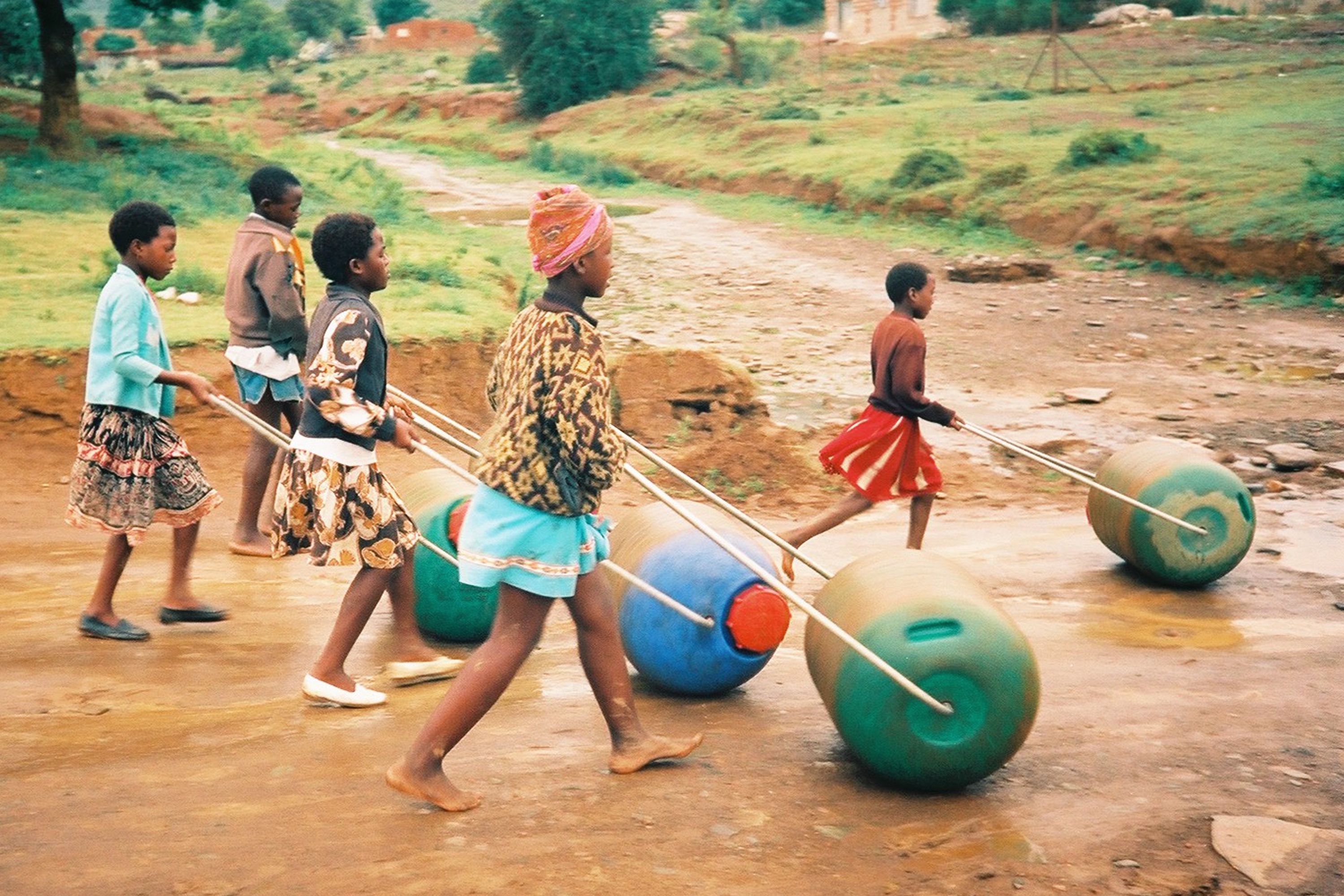 Image: Children pushing Hippo Rollers