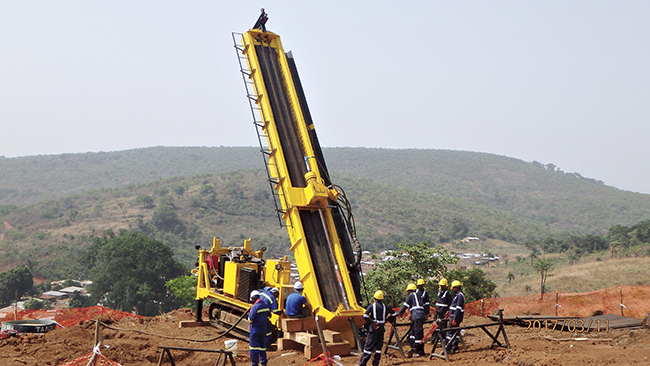 Image: Drilling with Dalakuru village and our camp in the background