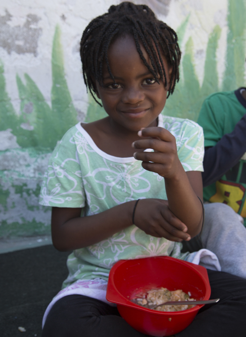 Image: Little girl in adverse poverty receiving a free meal